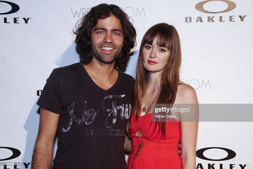 <a gi-track='captionPersonalityLinkClicked' href=/galleries/search?phrase=Adrian+Grenier&family=editorial&specificpeople=211413 ng-click='$event.stopPropagation()'>Adrian Grenier</a> and Emily Caldwell attend the Oakley and Wreckroom musical presentation at The W hotel on March 15, 2013 in Austin, Texas.