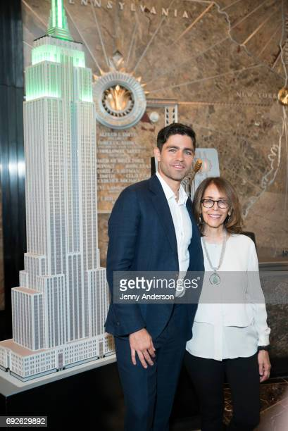 Adrian Grenier and his mother Karesse Grenier attend the lightining of the Empire State Building in commemoration of World Environment Day at The...