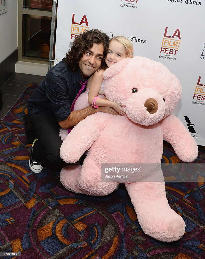 <a gi-track='captionPersonalityLinkClicked' href=/galleries/search?phrase=Adrian+Grenier&family=editorial&specificpeople=211413 ng-click='$event.stopPropagation()'>Adrian Grenier</a> and Mckenna Grace attend the 2013 Los Angeles Film Festival Premiere Of 'Goodbye World' at Regal Cinemas L.A. Live on June 15, 2013 in Los Angeles, California.
