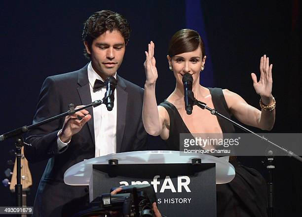 Adrian Grenier and Paz Vega speak onstage during amfAR's 21st Cinema Against AIDS Gala Presented By WORLDVIEW BOLD FILMS And BVLGARI at Hotel du...