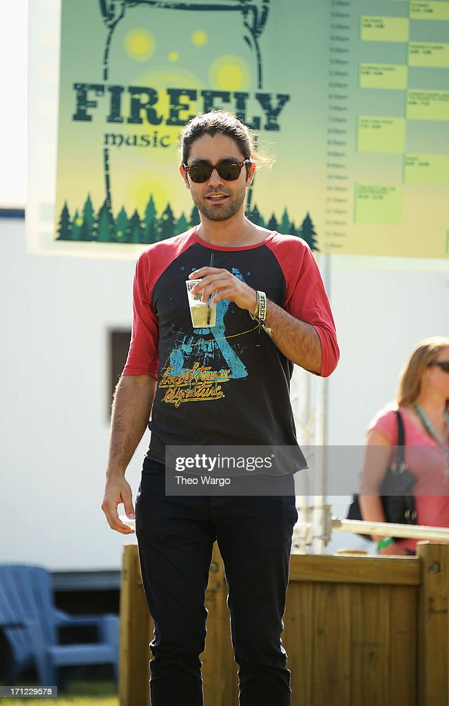 Adrian Grenier hangs out at the Artist Compound at the Firefly Music Festival at The Woodlands of Dover International Speedway on June 22, 2013 in Dover, Delaware.
