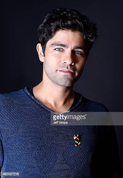 Adrian Grenier wears a pin to support #TackleEbola in a portrait at the Village at the Lift Presented by McDonald's McCafe during the 2015 Sundance...