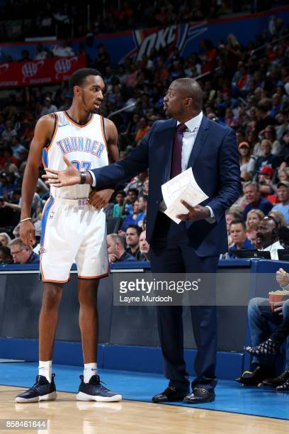 Adrian Griffin of the Oklahoma City Thunder talks with Terrance Ferguson of the Oklahoma City Thunder during the game against the New Orleans...