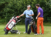 Adrian Harris and Thomas Moors of Broadstone Golf Club check the course planner during the The Lombard Trophy South Qualifier at Walton Heath Golf...