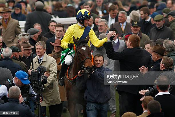 Adrian Heskin riding Martello Tower return after winning The Albert Bartlett Novices' Hurdle Race during Gold Cup day at the Cheltenham Festival at...