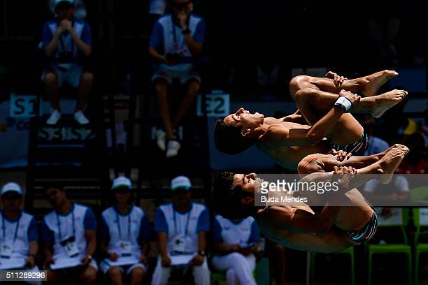 Adrian Infante and Daniel Pinto of Peru compete in the men's 3m synchro springboard preliminary as part of the 2016 FINA Diving World Cup at Maria...