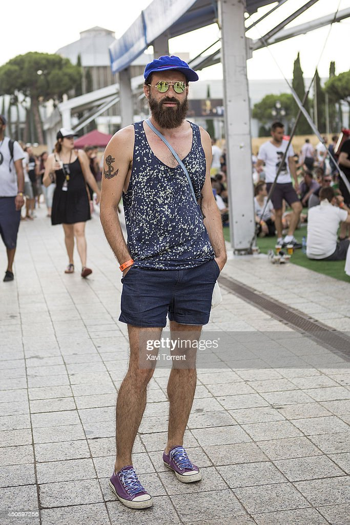 Adrian is wearing a t-shirt from Asos, pants from JJ market in Bangkok, footwear from Converse and a cap from Gambia on the Sonar Music Festival 2014 on June 14, 2014 in Barcelona, Spain.