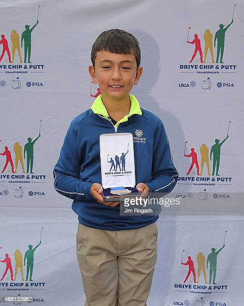 Adrian Jordan first place winner in the Boys 79 Driving Competition poses with his medal during the 2015 Drive Chip and Putt Championship at The...