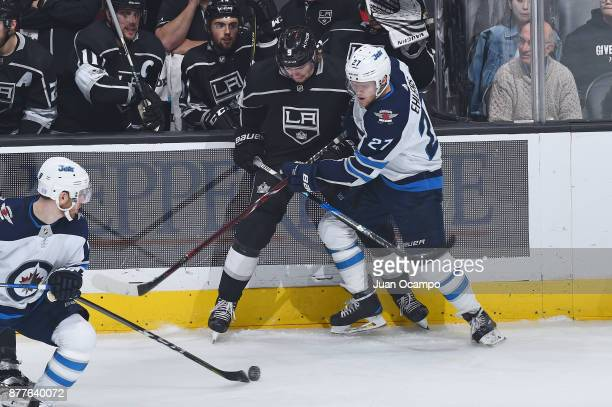 Adrian Kempe of the Los Angeles Kings battles for the puck against Nikolaj Ehlers of the Winnipeg Jets at STAPLES Center on November 22 2017 in Los...