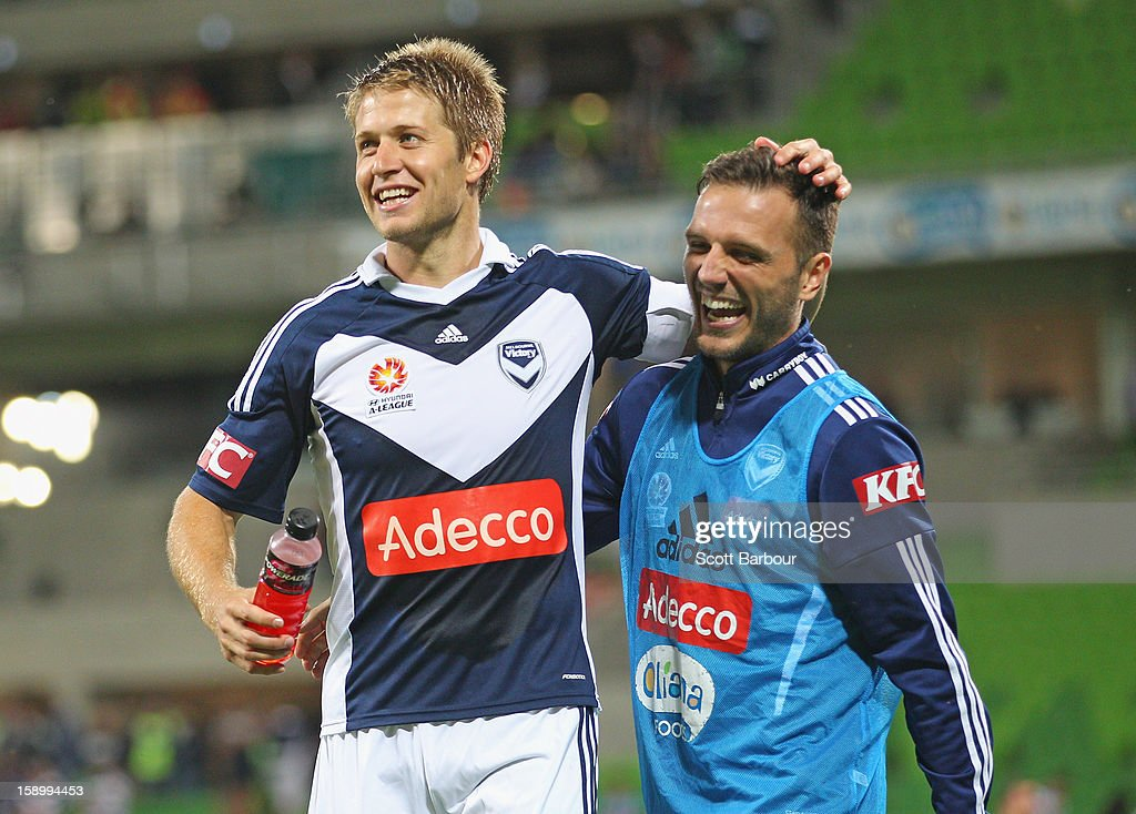 Adrian Leijer and Billy Celeski of the Victory celebrate after the round 15 A-League match between the Melbourne Victory and Wellington Phoenix at AAMI Park on January 5, 2013 in Melbourne, Australia.