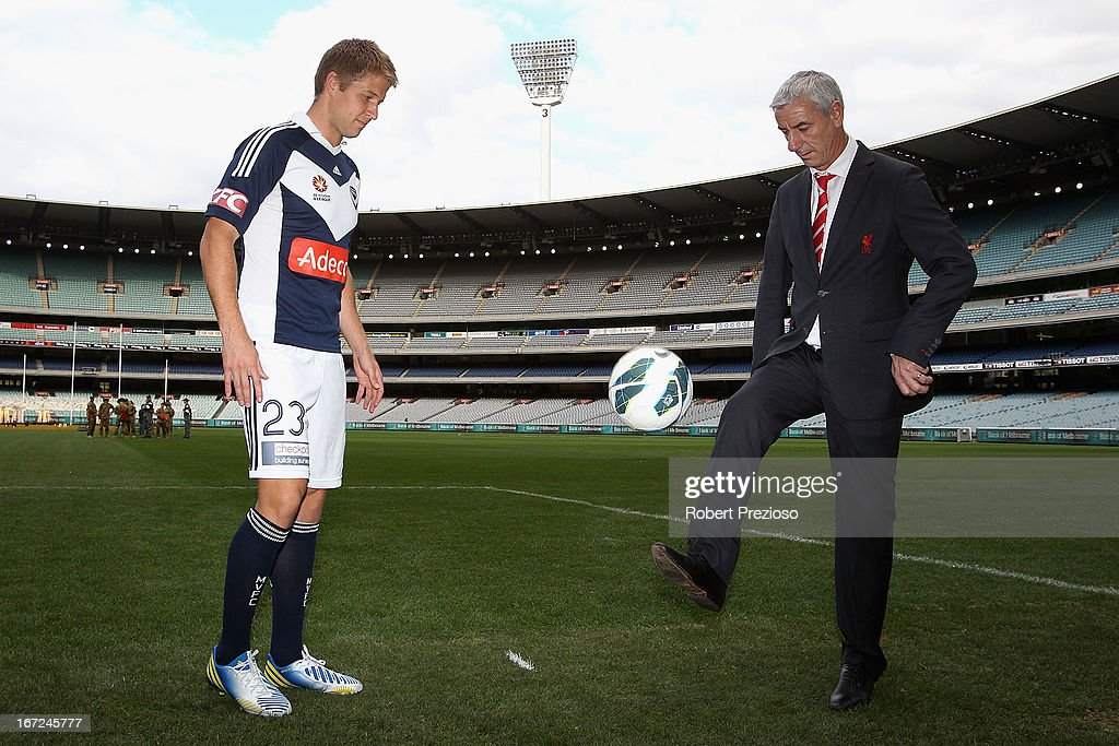 <a gi-track='captionPersonalityLinkClicked' href=/galleries/search?phrase=Adrian+Leijer&family=editorial&specificpeople=793956 ng-click='$event.stopPropagation()'>Adrian Leijer</a> Melbourne Victory captain and <a gi-track='captionPersonalityLinkClicked' href=/galleries/search?phrase=Ian+Rush&family=editorial&specificpeople=2107557 ng-click='$event.stopPropagation()'>Ian Rush</a> Liverpool FC Ambassador and former player pose for photos after a press conference at Melbourne Cricket Ground on April 23, 2013 in Melbourne, Australia. Liverpool FC will play Melbourne Victory in a friendly at the MCG on July 24th.