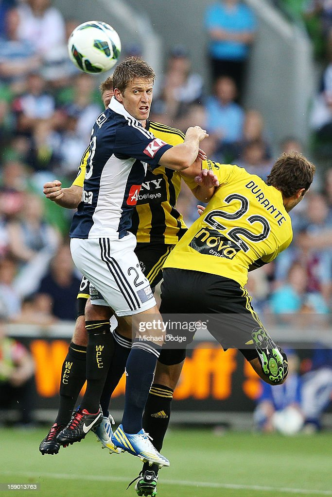 Adrian Leijer (L) of the Melbourne Victory contests for the ball against Andrew Durante of the Wellington Phoenix during the round 15 A-League match between the Melbourne Victory and Wellington Phoenix at AAMI Park on January 5, 2013 in Melbourne, Australia.
