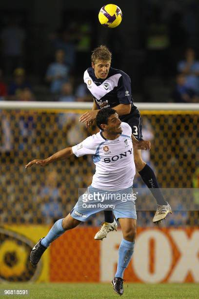 Adrian Leijer of the Victory heads the ball over the top of John Aloisi of Sydney during the ALeague Major Semi Final first leg match between the...