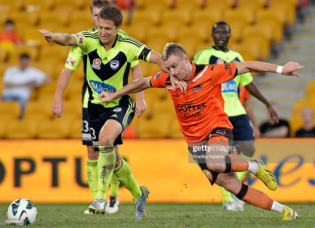 Adrian Leijer of the Victory is challenged by Besart Berisha of the Roar during the round 24 A-League match between the Brisbane Roar and the Melbourne Victory at Suncorp Stadium on March 9, 2013 in Brisbane, Australia.