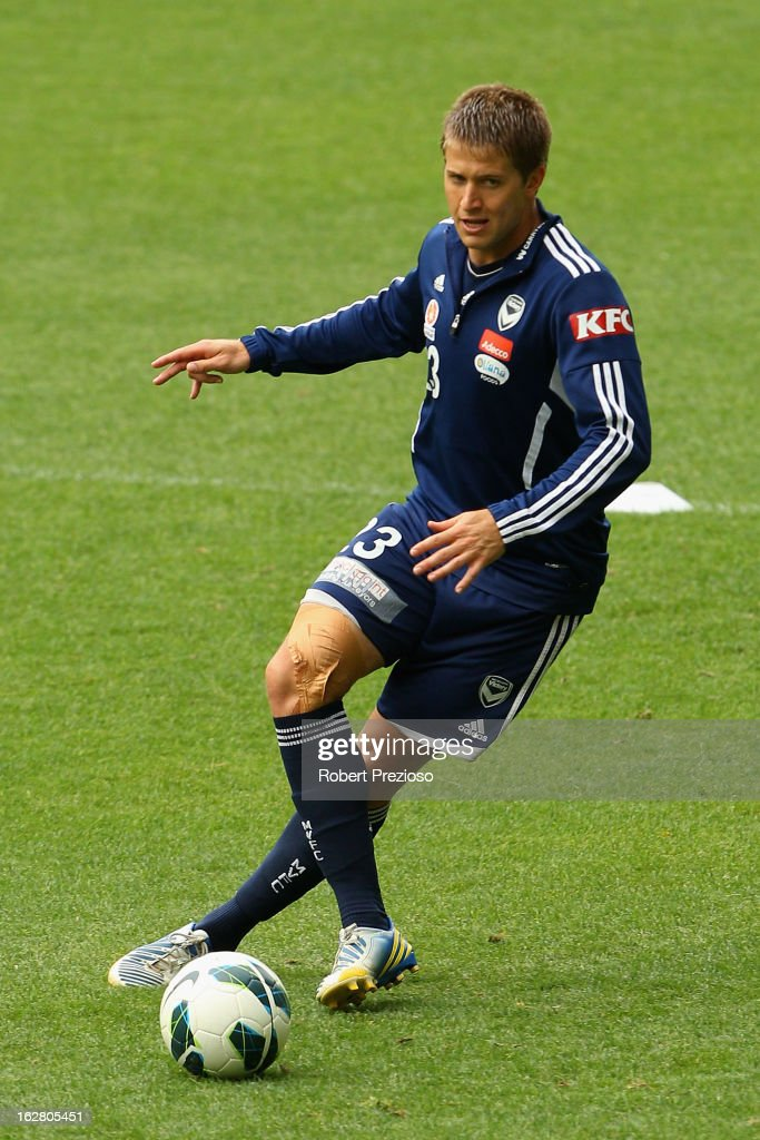 Adrian Leijer passes the ball during a Melbourne Victory A-League training session at AAMI Park on February 28, 2013 in Melbourne, Australia.
