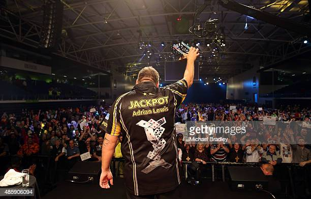 Adrian Lewis celebrates winning the final during the Auckland Darts Masters at The Trusts Arena on August 30 2015 in Auckland New Zealand