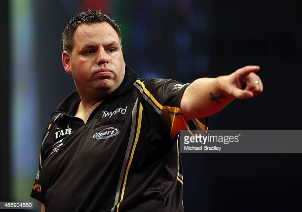 Adrian Lewis in action against Raymond van Barnevald in the final match during the Auckland Darts Masters at The Trusts Arena on August 30 2015 in...