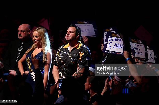 Adrian Lewis of England awaits to make his entrance during his semifinal match against Raymond van Barneveld of The Netherlands during the 2016...