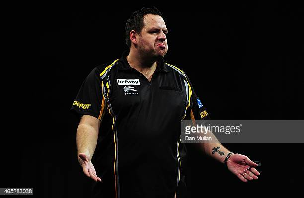 Adrian Lewis of England celebrates after winning a leg against Stephen Bunting of England during The Betway Premier League Darts at Westpoint Arena...