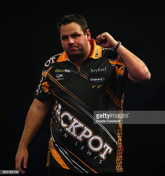 Adrian Lewis of England celebrates after winning his semifinal match against Raymond van Barneveld of the Netherlands during the 2016 William Hill...