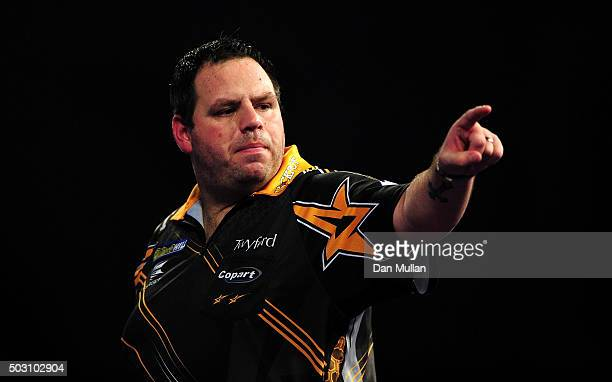 Adrian Lewis of England celebrates against Peter Wright of Scotland in their quarter final match during Day Thirteen of the 2016 William Hill PDC...