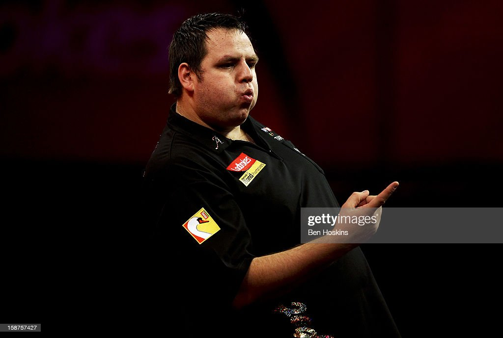 <a gi-track='captionPersonalityLinkClicked' href=/galleries/search?phrase=Adrian+Lewis&family=editorial&specificpeople=2109842 ng-click='$event.stopPropagation()'>Adrian Lewis</a> of England celebrates during his third round match against Kevin Painter on day eleven of the 2013 Ladbrokes.com World Darts Championship at the Alexandra Palace on December 27, 2012 in London, England.
