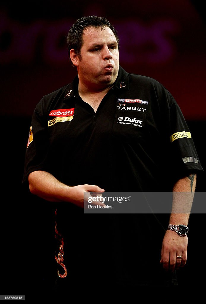 Adrian Lewis of England celebrates during his third round match against Kevin Painter on day eleven of the 2013 Ladbrokes.com World Darts Championship at the Alexandra Palace on December 27, 2012 in London, England.