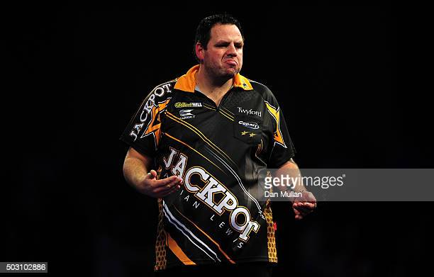 Adrian Lewis of England celebrates victory over Peter Wright of Scotland in their quarter final match during Day Thirteen of the 2016 William Hill...