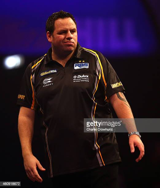 Adrian Lewis of England celebrates winning a set during his third round match against Raymond van Barneveld of Holland during the William Hill PDC...