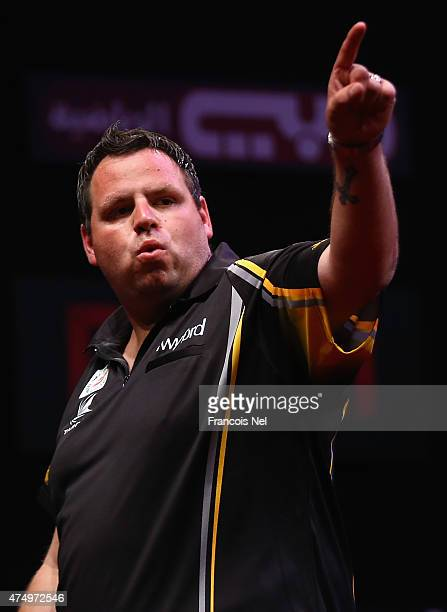 Adrian Lewis of England celebrates winning against Stephen Bunting of England during the 2015 Dubai Duty Free Darts Masters QuarterFinal match at...
