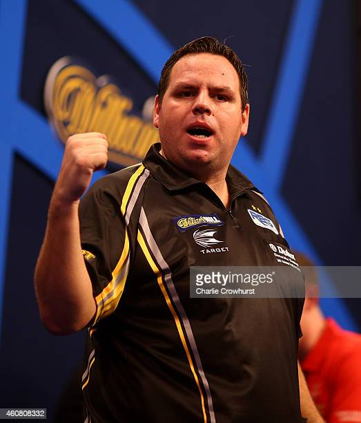 Adrian Lewis of England celebrates winning his first round match against David Pallett of England during the William Hill PDC World Darts...