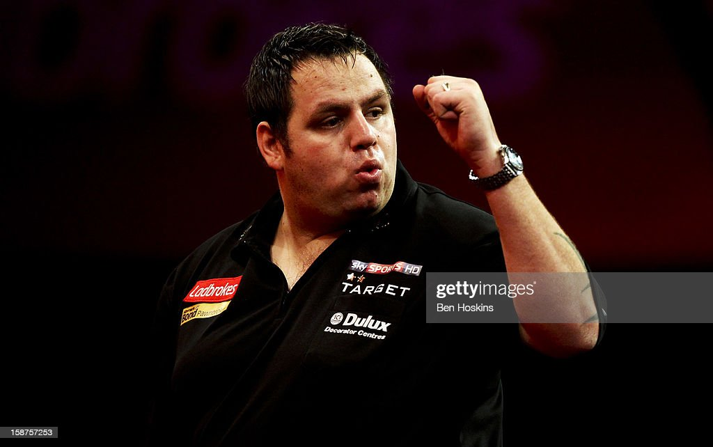 <a gi-track='captionPersonalityLinkClicked' href=/galleries/search?phrase=Adrian+Lewis&family=editorial&specificpeople=2109842 ng-click='$event.stopPropagation()'>Adrian Lewis</a> of England celebrates winning the first set during his third round match against Kevin Painter on day eleven of the 2013 Ladbrokes.com World Darts Championship at the Alexandra Palace on December 27, 2012 in London, England.