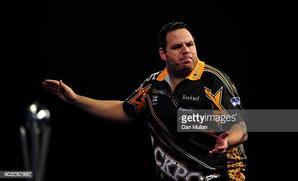 Adrian Lewis of England celebrates winning the second set against Gary Anderson of Scotland in the final match during Day Fifteen of the 2016 William...
