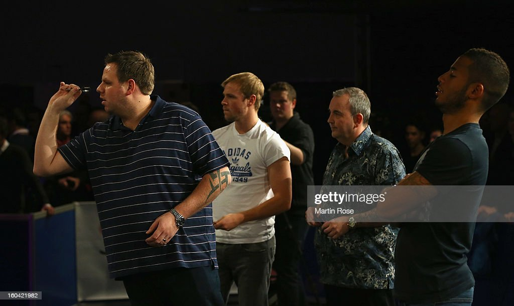 <a gi-track='captionPersonalityLinkClicked' href=/galleries/search?phrase=Adrian+Lewis&family=editorial&specificpeople=2109842 ng-click='$event.stopPropagation()'>Adrian Lewis</a> of England in action during a dart show tournament at between team England and Hamburger SV at Imtech Arena on January 31, 2013 in Hamburg, Germany.