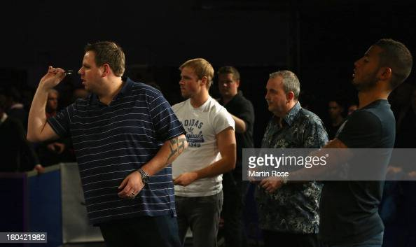 Adrian Lewis of England in action during a dart show tournament at between team England and Hamburger SV at Imtech Arena on January 31 2013 in...