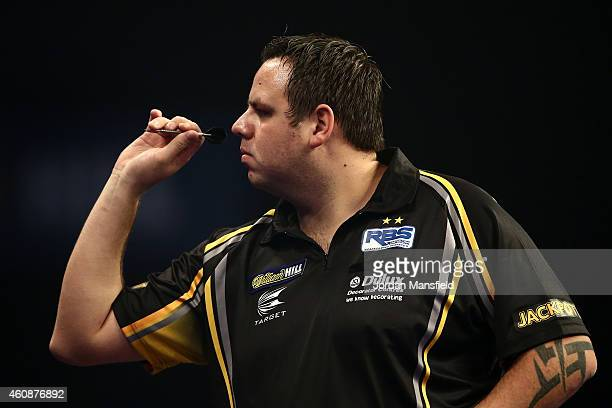 Adrian Lewis of England in action during his second round match against Keegan Brown of England on Day Eight of the William Hill PDC World Darts...