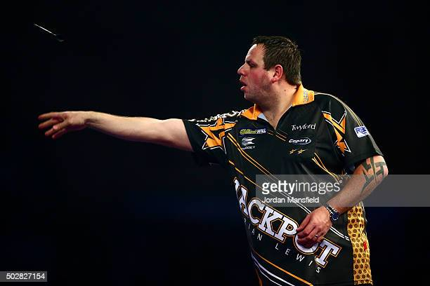 Adrian Lewis of England in action during his third round match against Mensur Suljovic of Austria on Day Eleven of the 2016 William Hill PDC World...