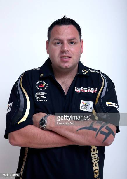 Adrian Lewis of England poses for a portrait prior to the start of the draw ceremony for the Dubai Duty Free Darts Masters to reveal the Quarter...