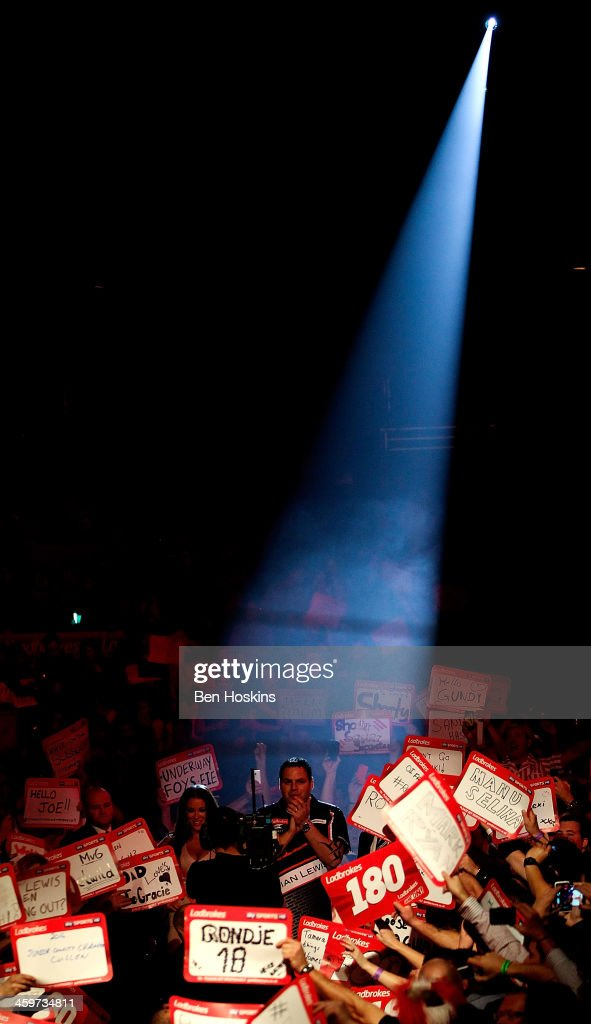 <a gi-track='captionPersonalityLinkClicked' href=/galleries/search?phrase=Adrian+Lewis&family=editorial&specificpeople=2109842 ng-click='$event.stopPropagation()'>Adrian Lewis</a> of England prepares to walk on prior to his quarter final match against James Wade of England on day fourteen of the Ladbrokes.com World Darts Championship at Alexandra Palace on December 29, 2013 in London, England.