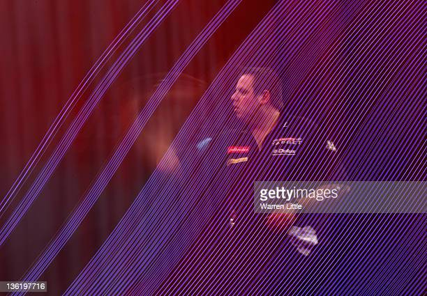 Adrian Lewis of England throws against Wayne Jones of England during Day 11 of the 2012 Ladbrokescom World Darts Championship at Alexandra Palace on...