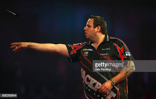 Adrian Lewis of England throws during his first round match against Magnus Caris of Sweden during day five of the 2017 William Hill PDC Darts...