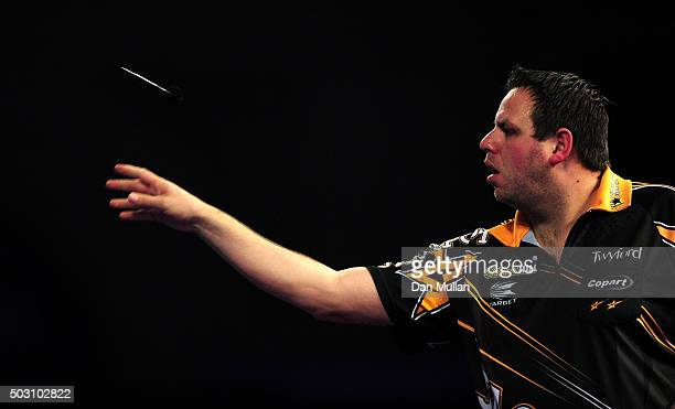 Adrian Lewis of England throws during his quarter final match against Peter Wright of Scotland during Day Thirteen of the 2016 William Hill PDC World...