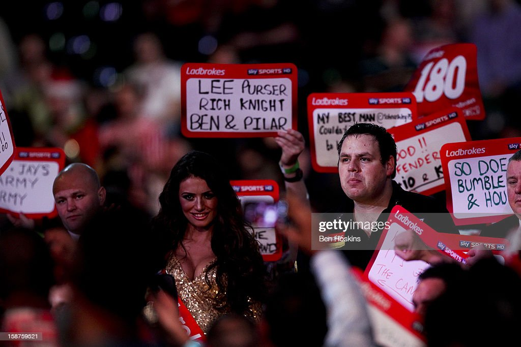 <a gi-track='captionPersonalityLinkClicked' href=/galleries/search?phrase=Adrian+Lewis&family=editorial&specificpeople=2109842 ng-click='$event.stopPropagation()'>Adrian Lewis</a> of England walks on prior to his third round match against Kevin Painter on day eleven of the 2013 Ladbrokes.com World Darts Championship at the Alexandra Palace on December 27, 2012 in London, England.