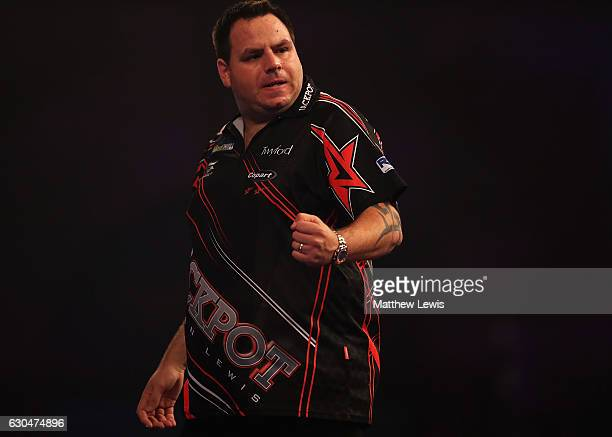 Adrian Lewis of Great Britain celebrates winning the first set against Joe Cullen of Great Britain during day nine of the 2017 William Hill PDC World...