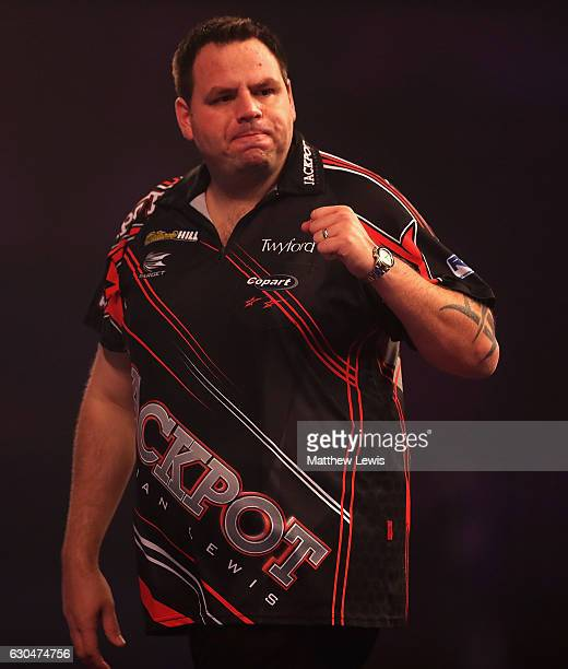 Adrian Lewis of Great Britain celebrates winning the second set against Joe Cullen of Great Britain during day nine of the 2017 William Hill PDC...