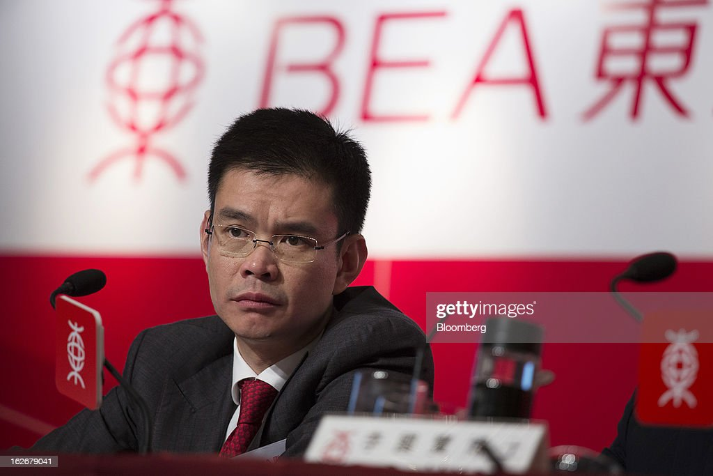 Adrian Li, deputy chief executive officer of Bank of East Asia Ltd. (BEA), attends the company's annual results news conference in Hong Kong, China, on Tuesday, Feb. 26, 2013. Bank of East Asia, Hong Kong's largest family-run lender, said 2012 profit jumped 39 percent as trading income climbed, helping offset a decline in profit from the mainland China business. Photographer: Jerome Favre/Bloomberg via Getty Images