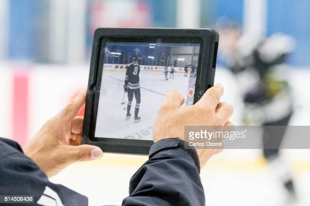 TORONTO ON JULY Adrian Lomonaco director of on ice at Journey to Excel records video on an iPad during the practice Don Meehan's agency Newport...