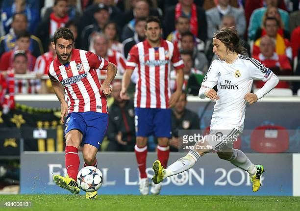 Adrian Lopez Alvarez of Atletico Madrid and Luka Modric of Real Madrid in action during the UEFA Champions League final between Real Madrid and...