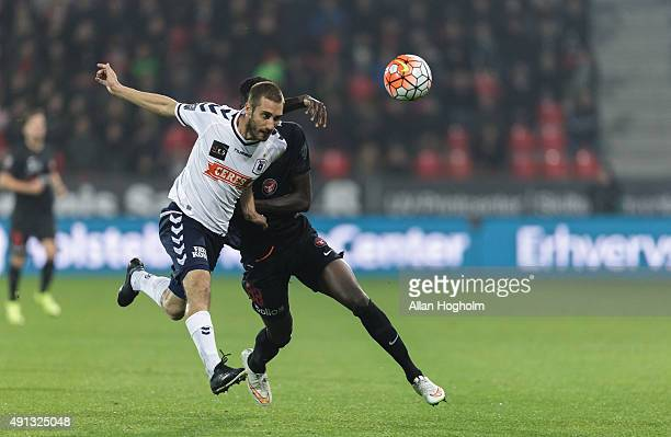 Adrian Lopez of AGF Aarhus and Paul Onuachu of FC Midtjylland compete for the ball during the Danish Alka Superliga match between FC Midtjylland and...