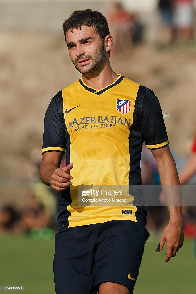 Adrian Lopez of Atletico de Madrid looks on during the Jesus Gil y Gil Trophy between Club Atletico de Madrid and Numancia C. D. at Sporting Club Uxama on July 21, 2013 in Burgo de Osma, Soria, Spain.